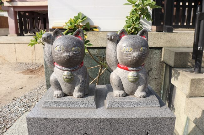 Imado shrine couple lucky cat stone zoom in Asakusa Japan